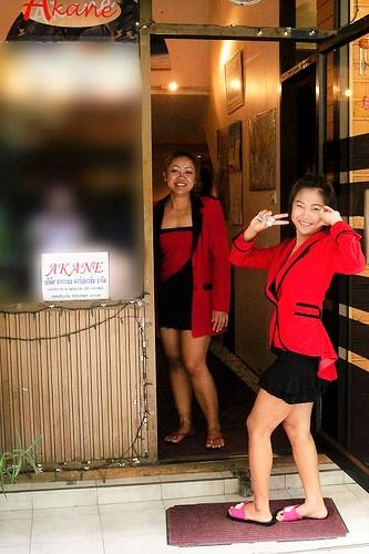 Waiting for customers outside Akane Fashion Massage
