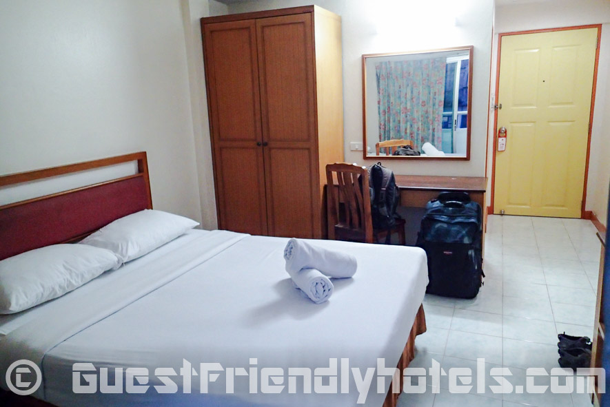 Amenities of the Standard room at the Eastiny Bella Vista Hotel are very basic with wardrobe and small table