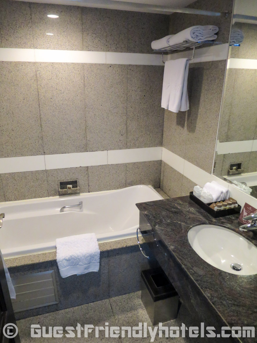 Bathroom of the Grande Superior room could ro with a refresh inside the Majestic Grande hotel in Bangkok