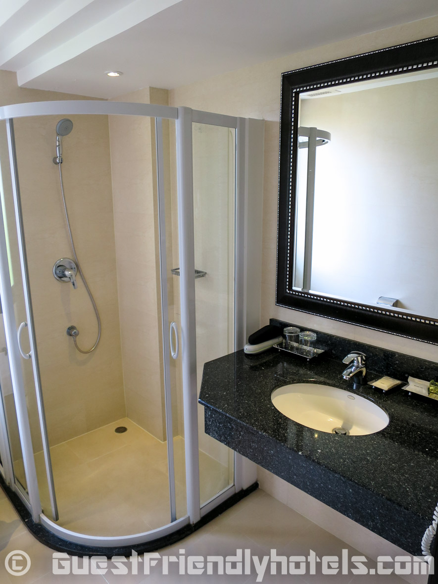 Bathroom shower in standard rooms of the Dawin Bangkok Hotel