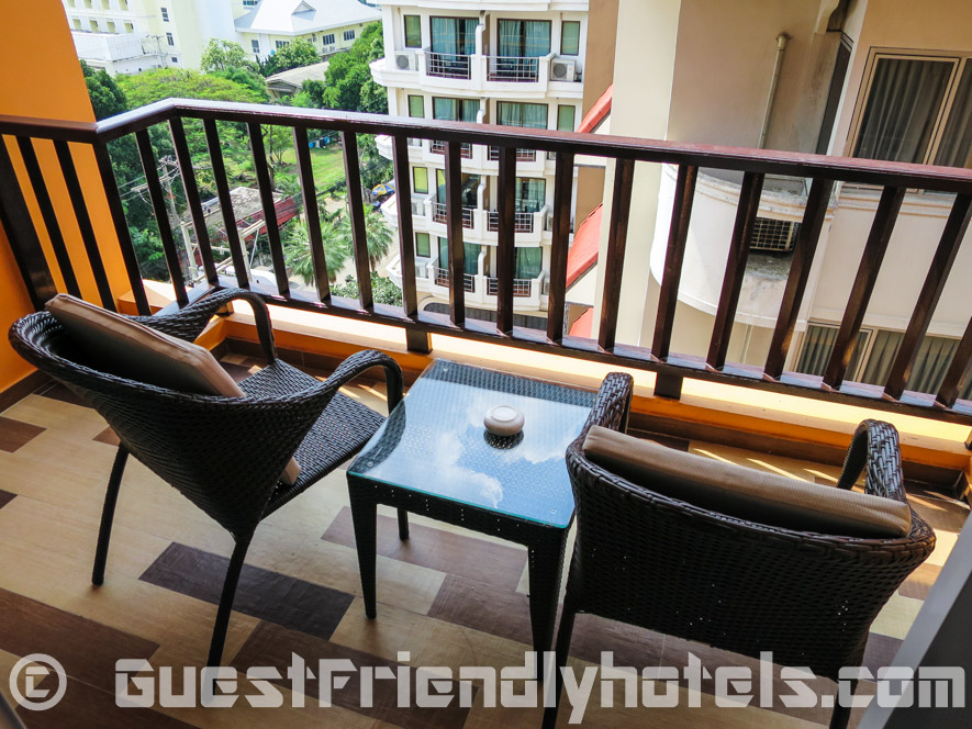 Grabbing a little fresh air from the room balcony at Pattaya Blue Sky Hotel