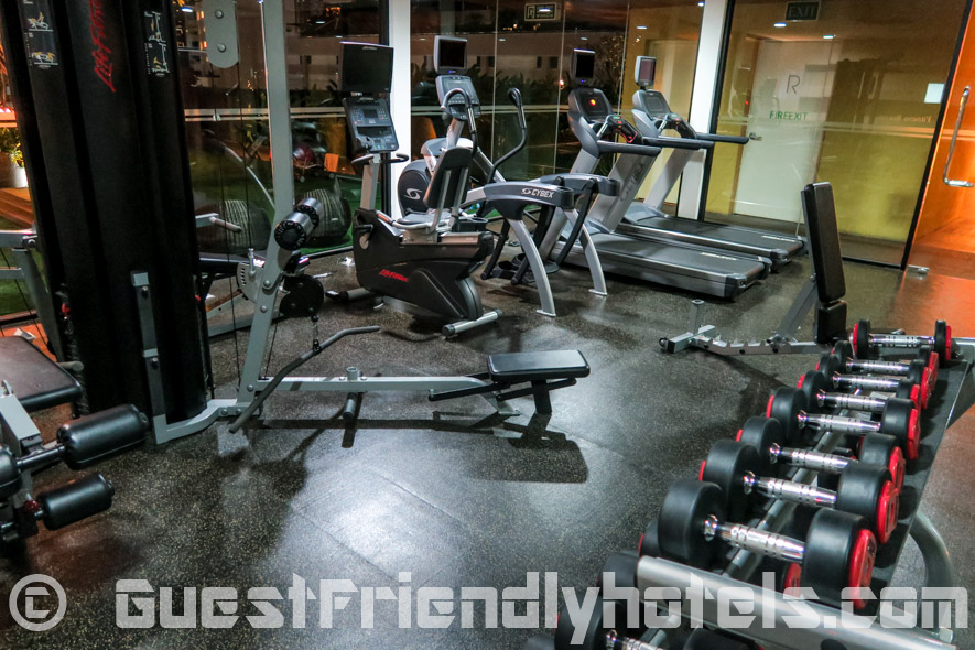 Gym next to pool in Best Western Premier Sukhumvit hotel