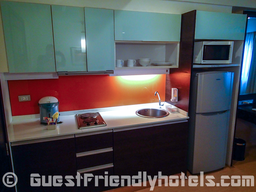 Kitchen area with large refrigerator inside Deluxe Room of the Aspen Suites Hotel