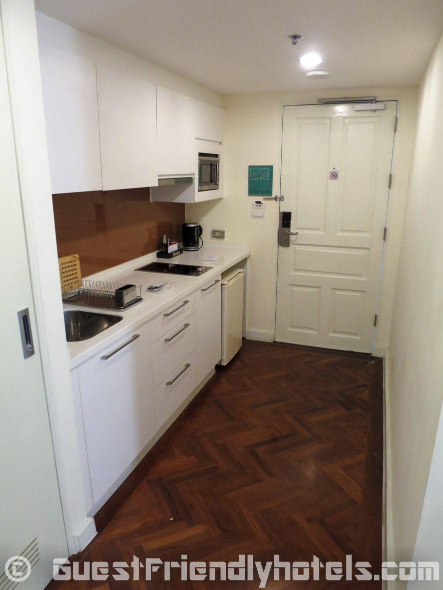 Kitchenette with washing machine and dryer in Studios of Phachara Suites_