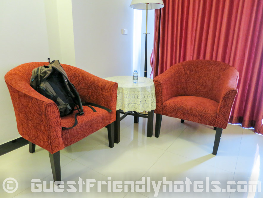 Little lounge area with two comfortable chairs and table at the Pattaya Blue Sky Hotel