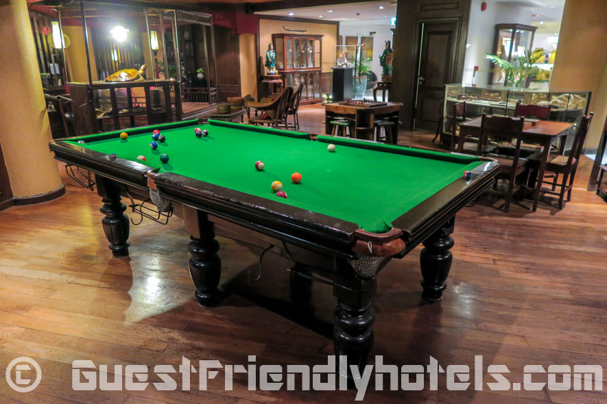 Lounge room with various board games and a pool table at the back of the bar in Siam Bayshore Resort