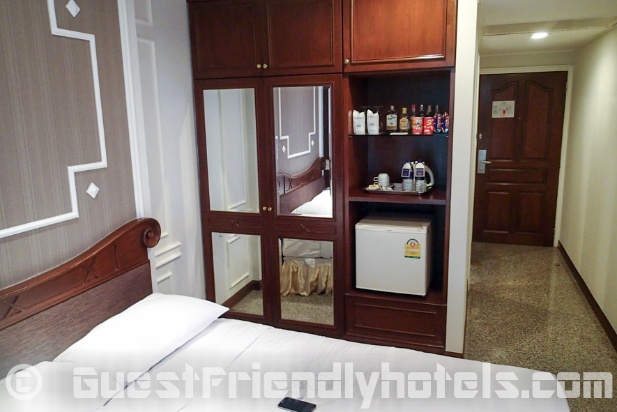 Majestic Suite Hotel -Superior room closet and minibar is right next to the bed-2