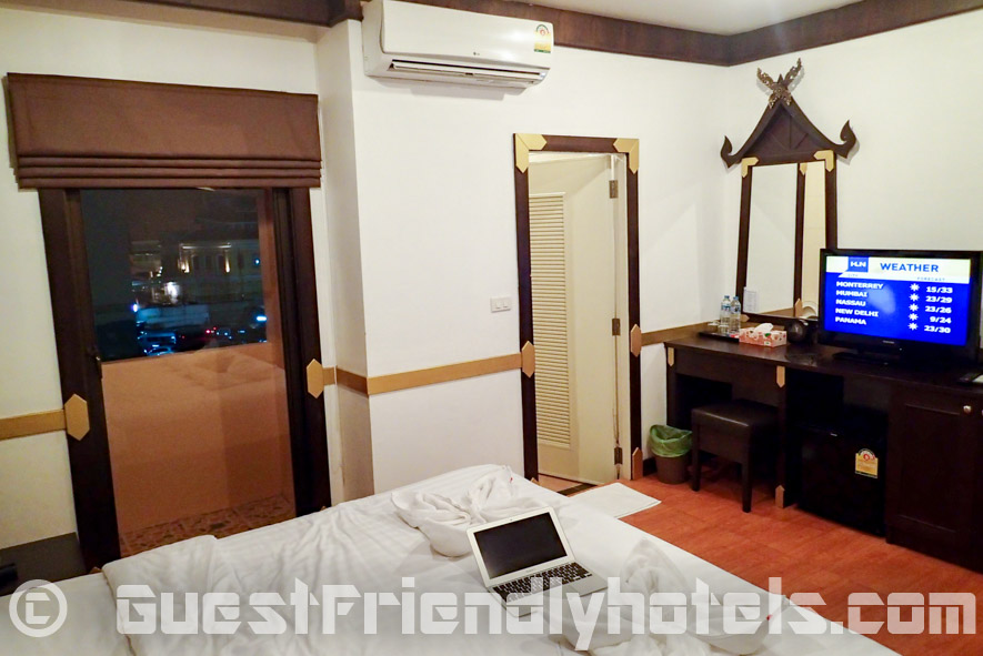 On the other side of the bed is a door leading to the small balcony in the and the other to the bathroom in Apsara Residence