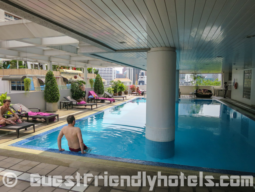 Outdoor swimming Pool area in Phachara Suites