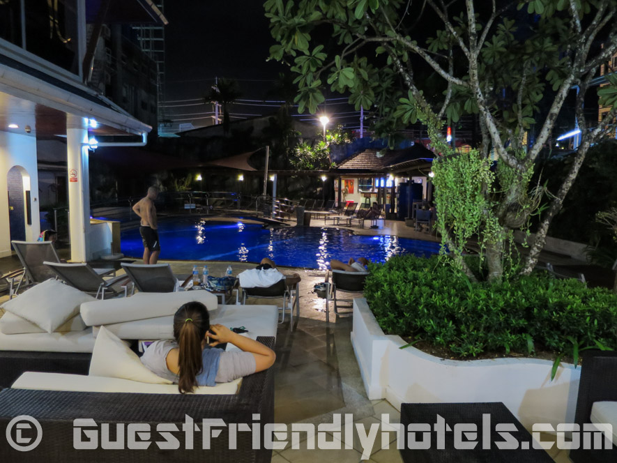 Relaxing by the pool at night in the The Yorkshire Hotel in Patong