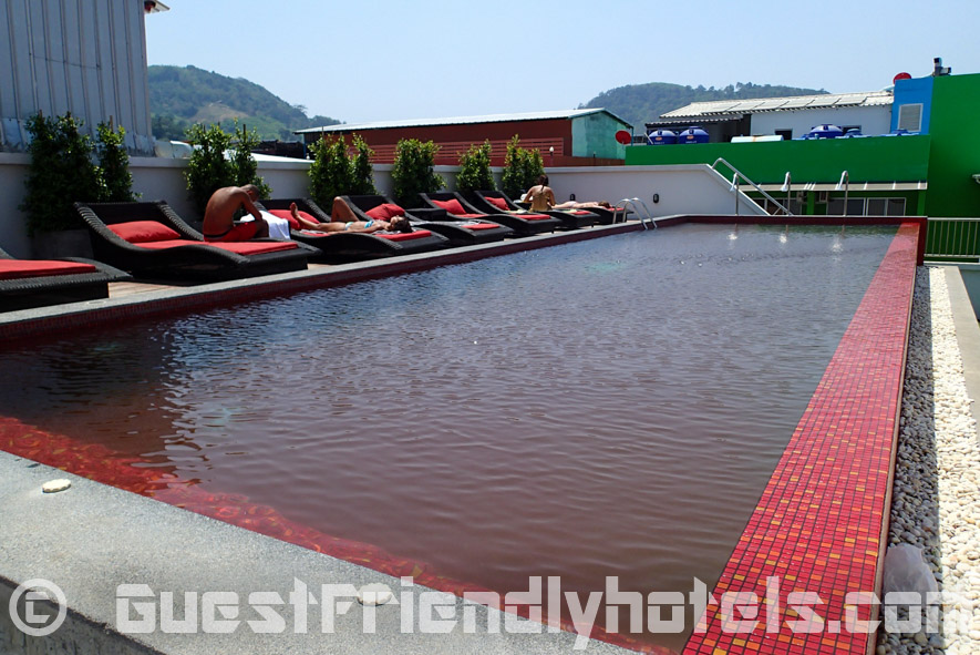 Rooftop swimming pool area at Alfresco Phuket Hotel