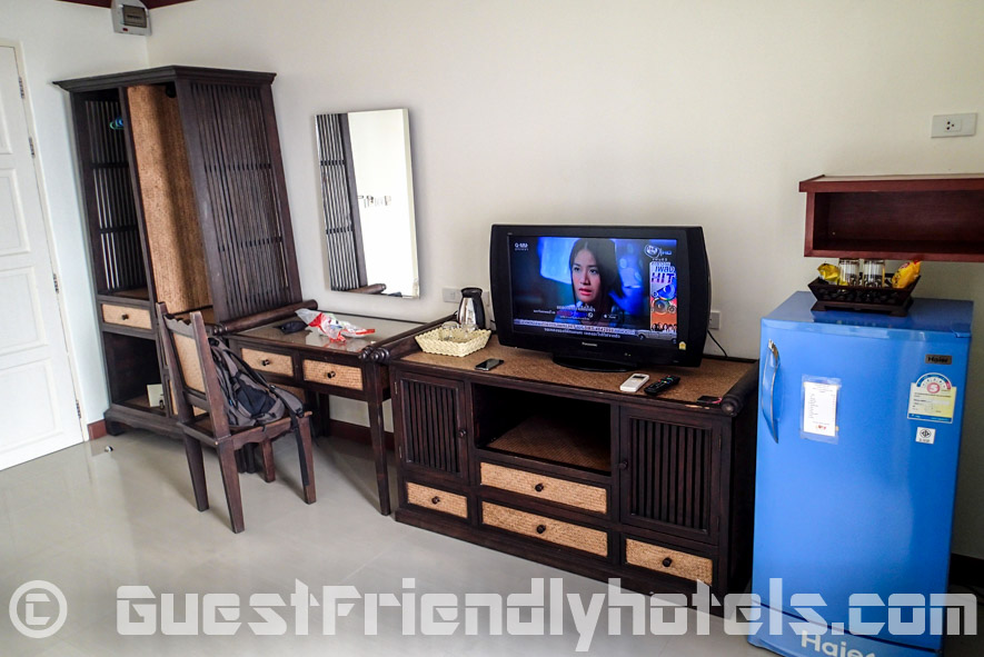 View of room amenities that include open wardrobe and TV in Baan Sila Pattaya
