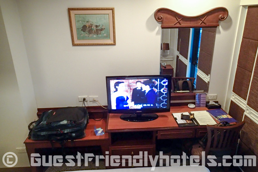 Samsung Flatscreen and desk opposite bed in Majestic Suite Hotel -Superior Queensize room