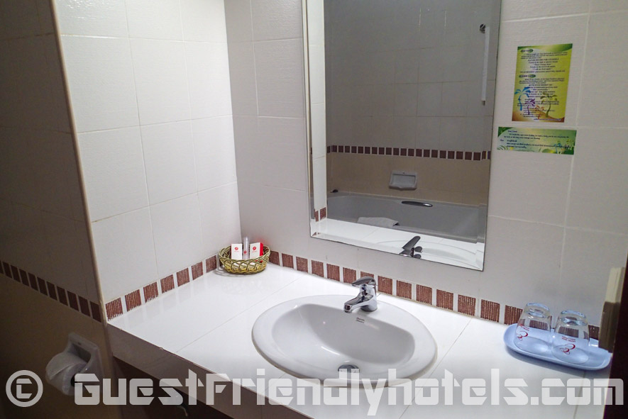 Sink and mirror area of the bathroom inside the Eastiny Seven Hotel