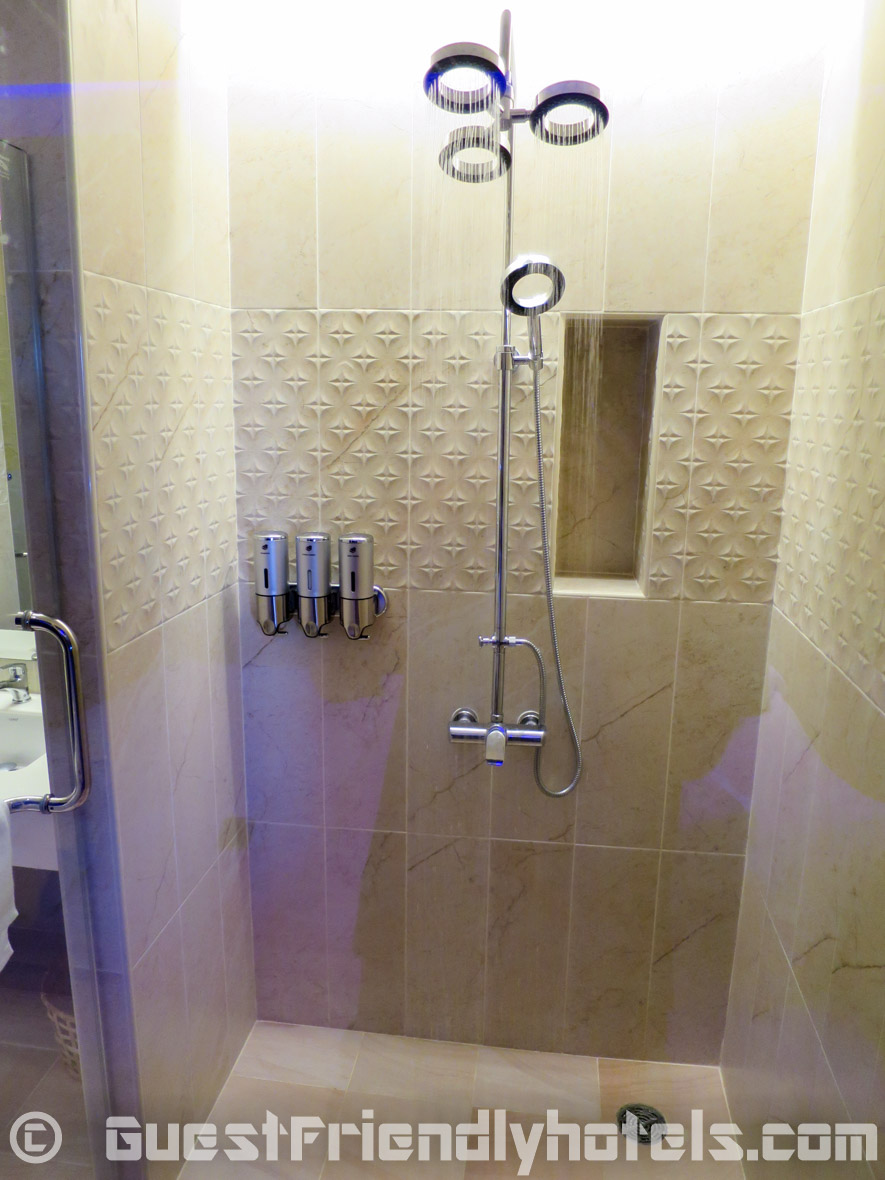 Standard shower head along with an adjustable rainfall shower head inside the bathrooms of Tweet Tweet Nest Pattaya Hotel