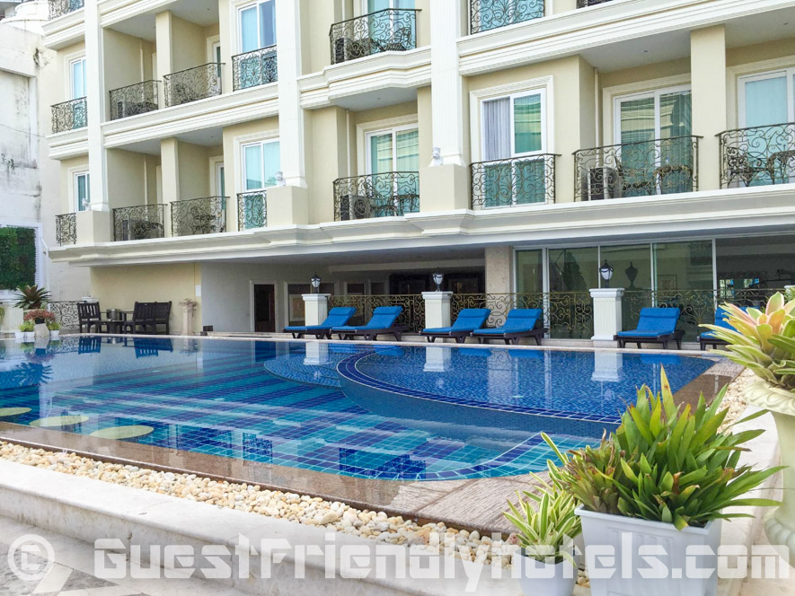 Swimming pool facing the ocean is found on the 3rd floor and has lots lots of beds and umbrellas
