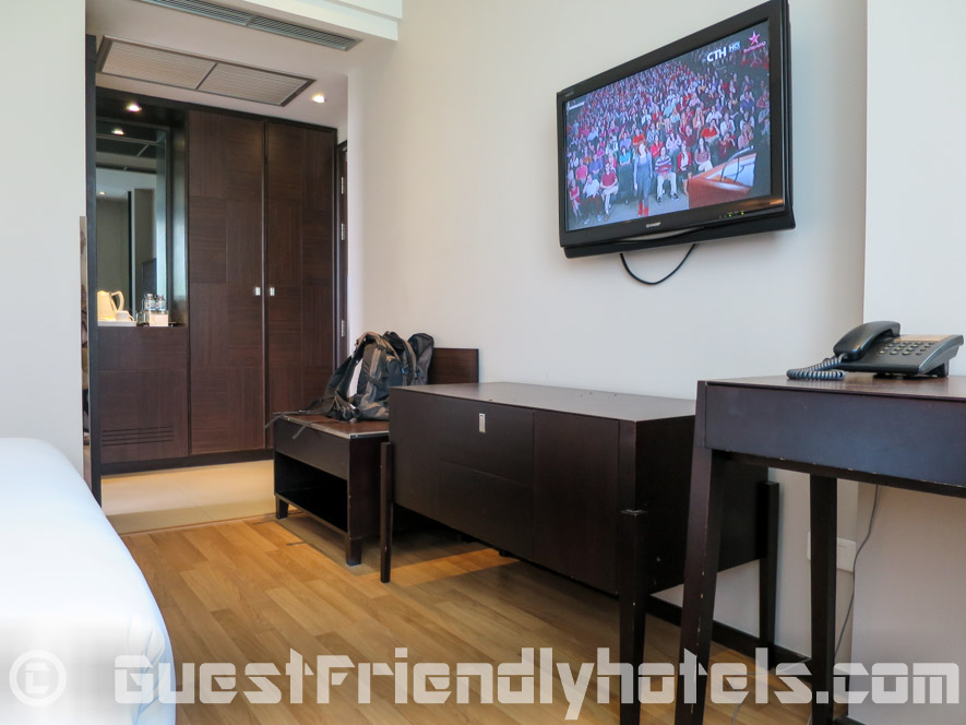 The Dawin Bangkok Hotel room amenities with TV and closet
