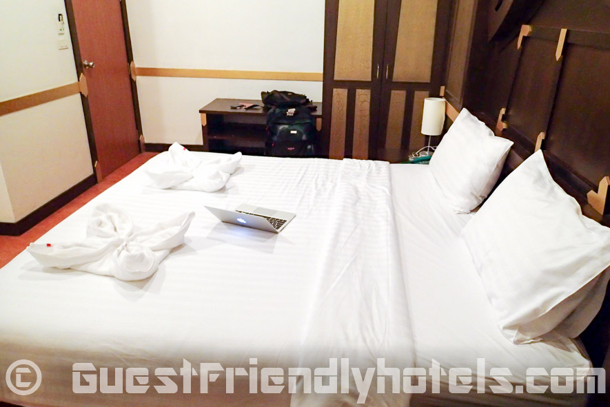 The bed is of good size and takes most of the place in their standard room at Apsara Residence
