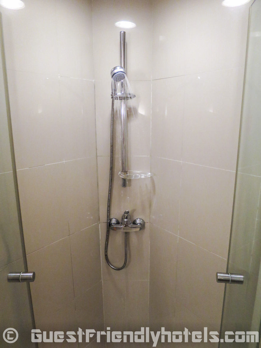The shower inside Ibis Pattaya Hotel bathroom