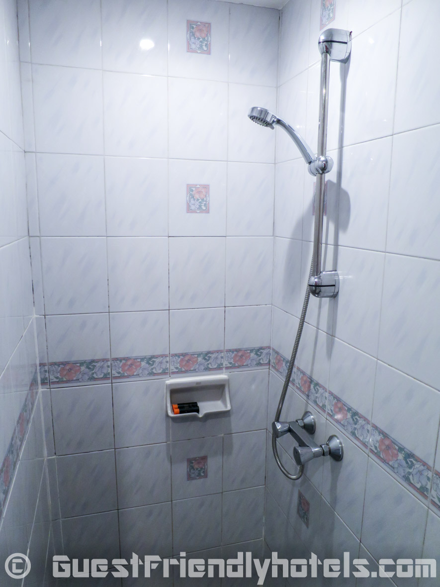 The shower inside the Standard Deluxe Room at The Yorkshire Hotel in Phuket