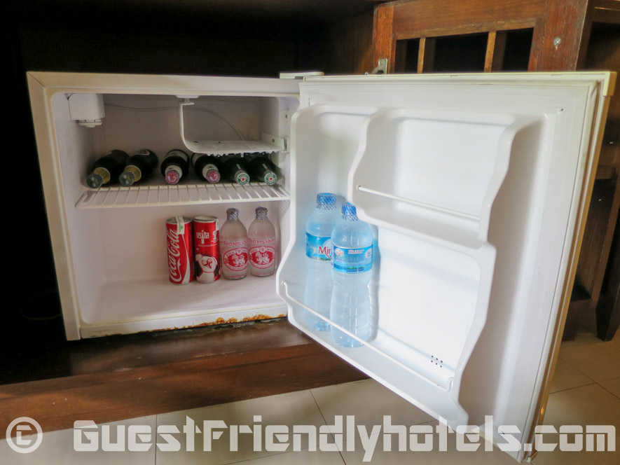 The small room mini-bar with a few drinks inside the Coconut Village Resort