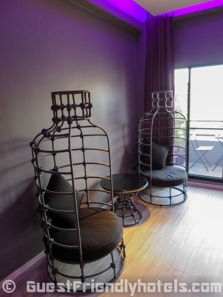 Two bird nest themed chairs with coffee table at the back of the Superior room at the Tweet Tweet Nest Pattaya Hotel