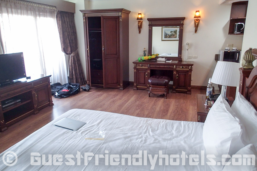Wooden furniture and floors throughout studio in LK Metropole