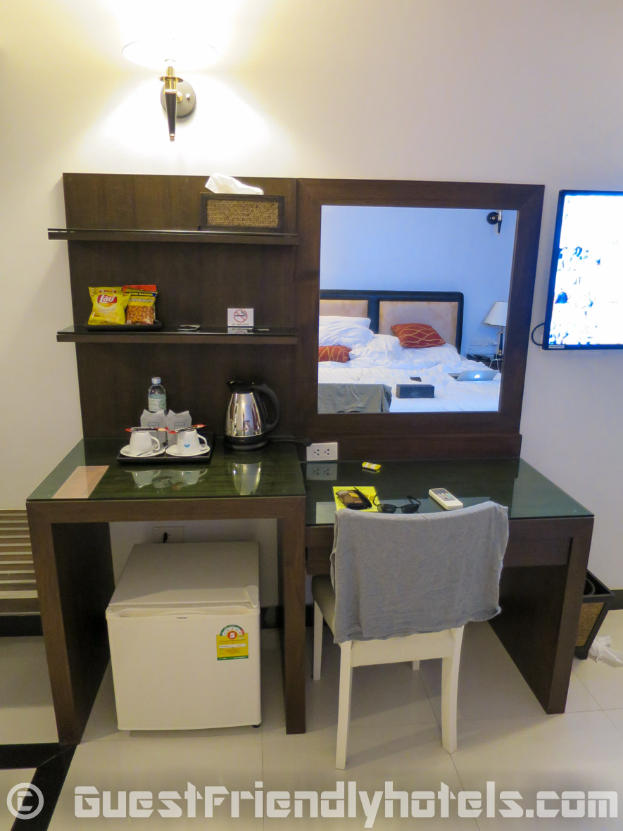 minibar area with small desk inside the superior rooms of the Pattaya Blue Sky Hotel